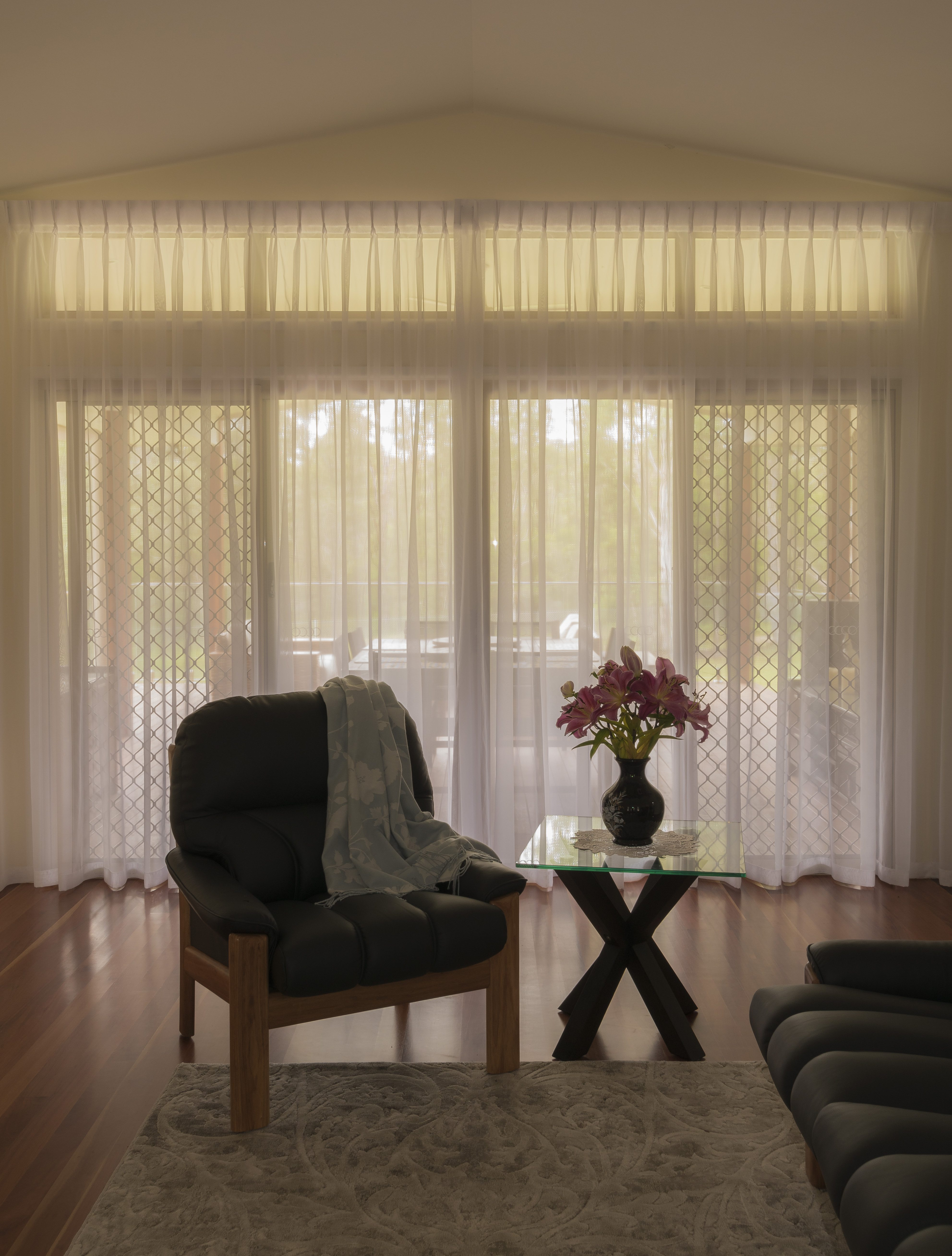 media with straight self piped pelmets and matching single pinch pleat curtains.