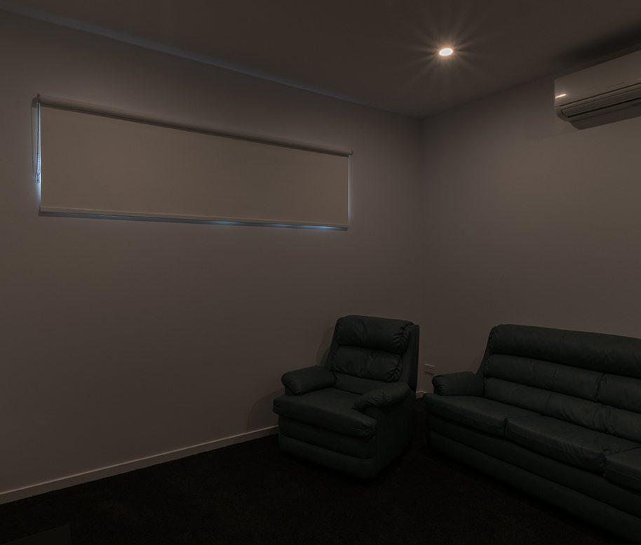 Blockout roller blind in media room
