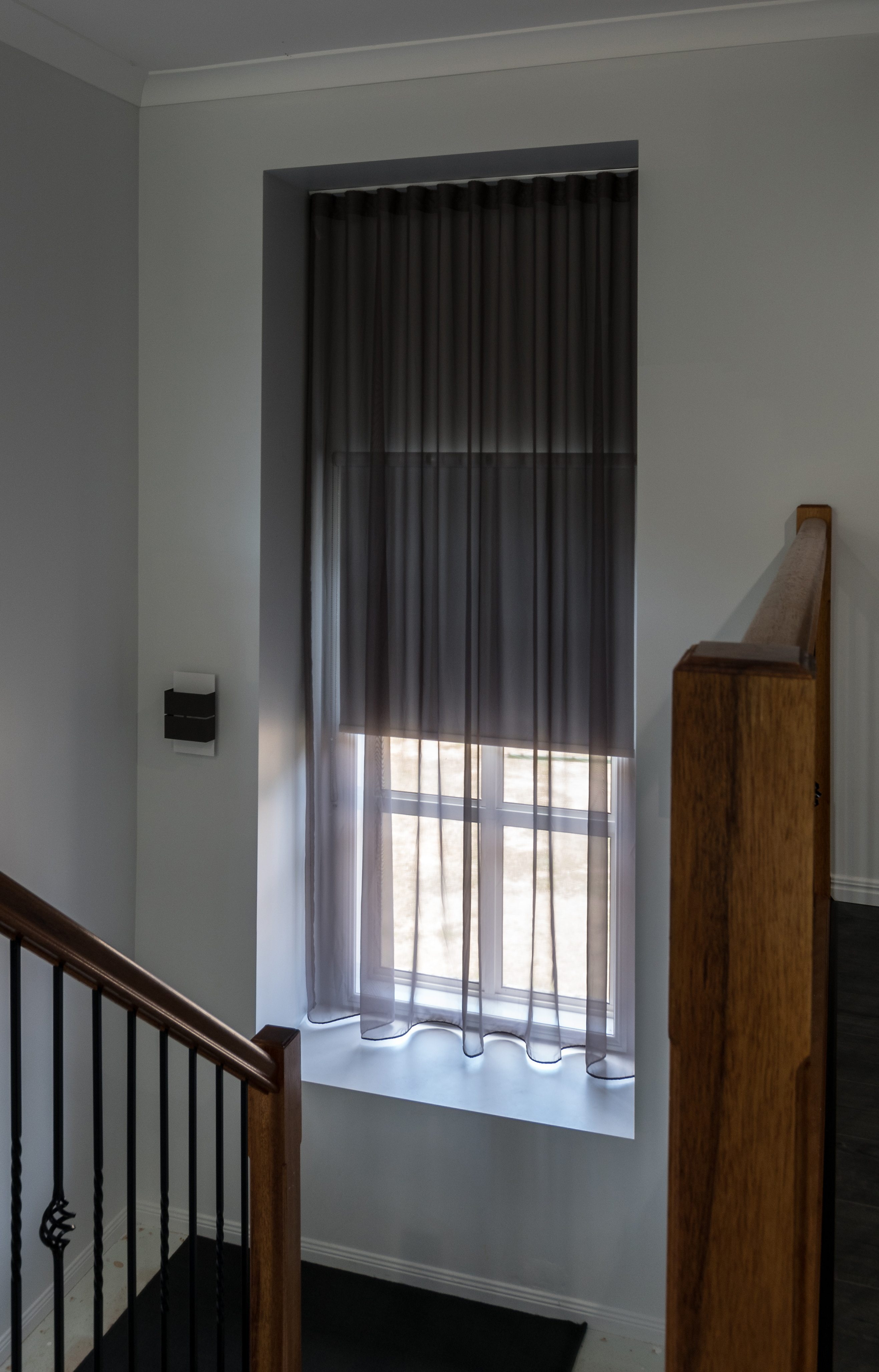 Stairwell recess S fold sheer with blind behind