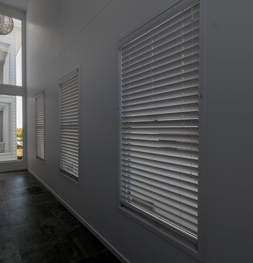 Three venetian blinds down hallway