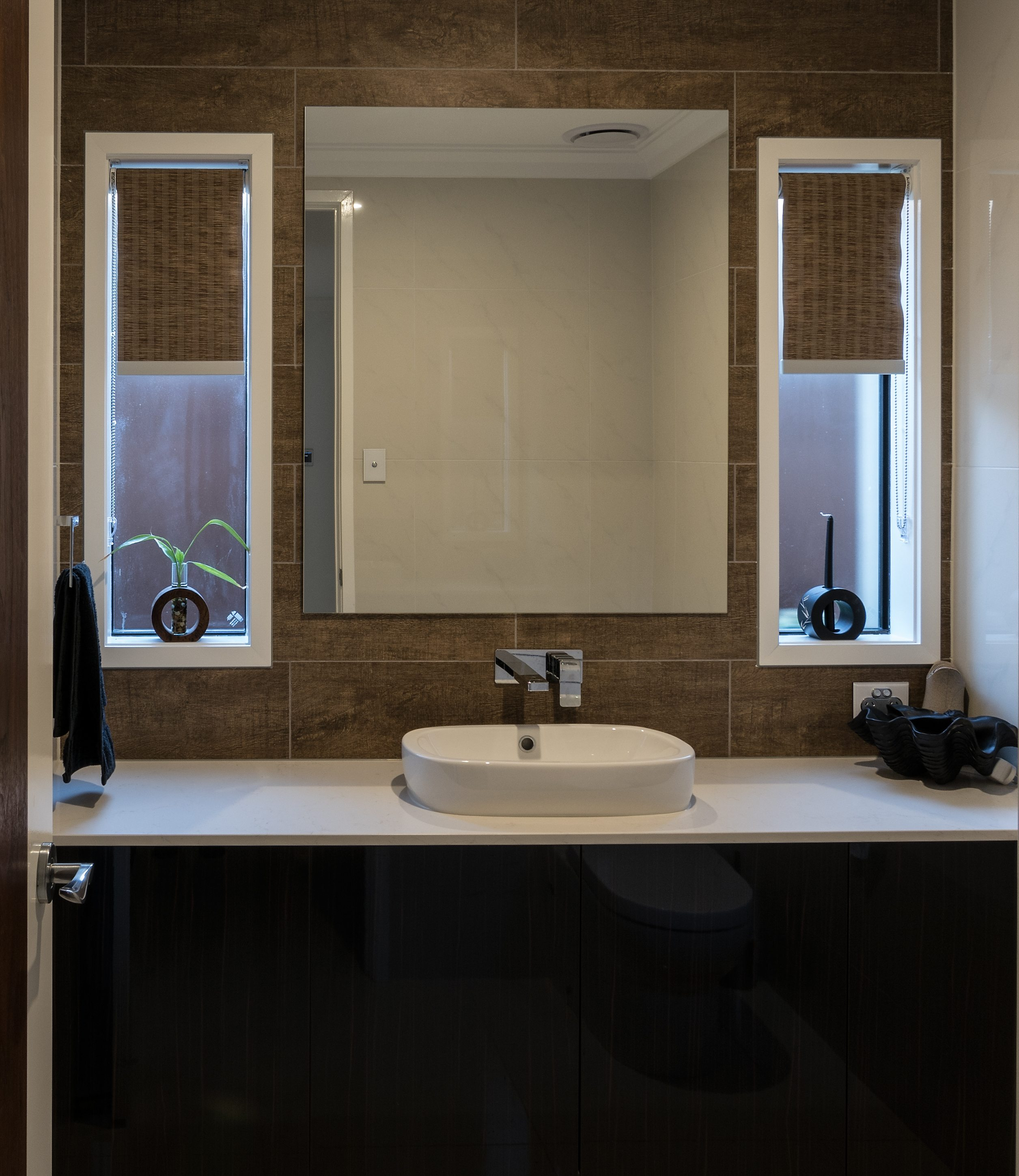 Textured double blind in bathroom