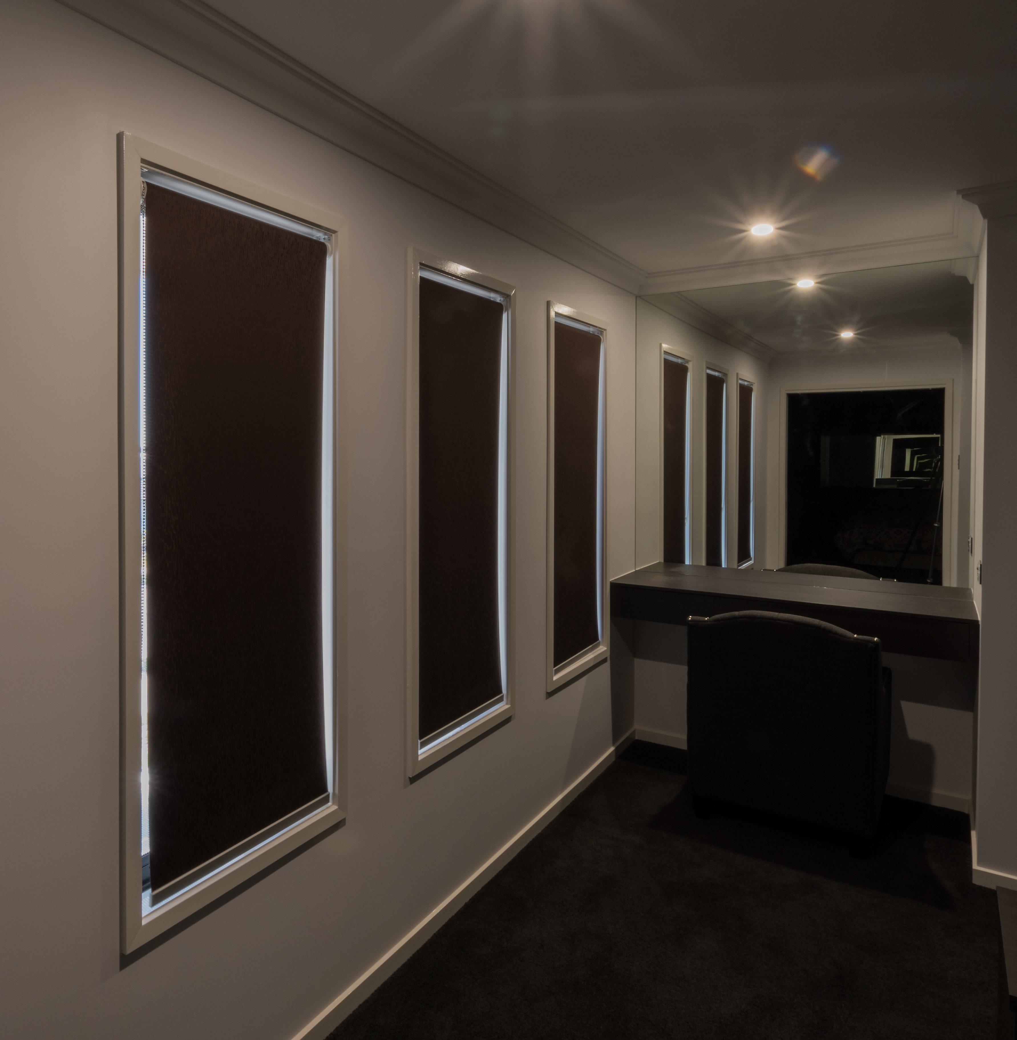 Three dark roller blinds