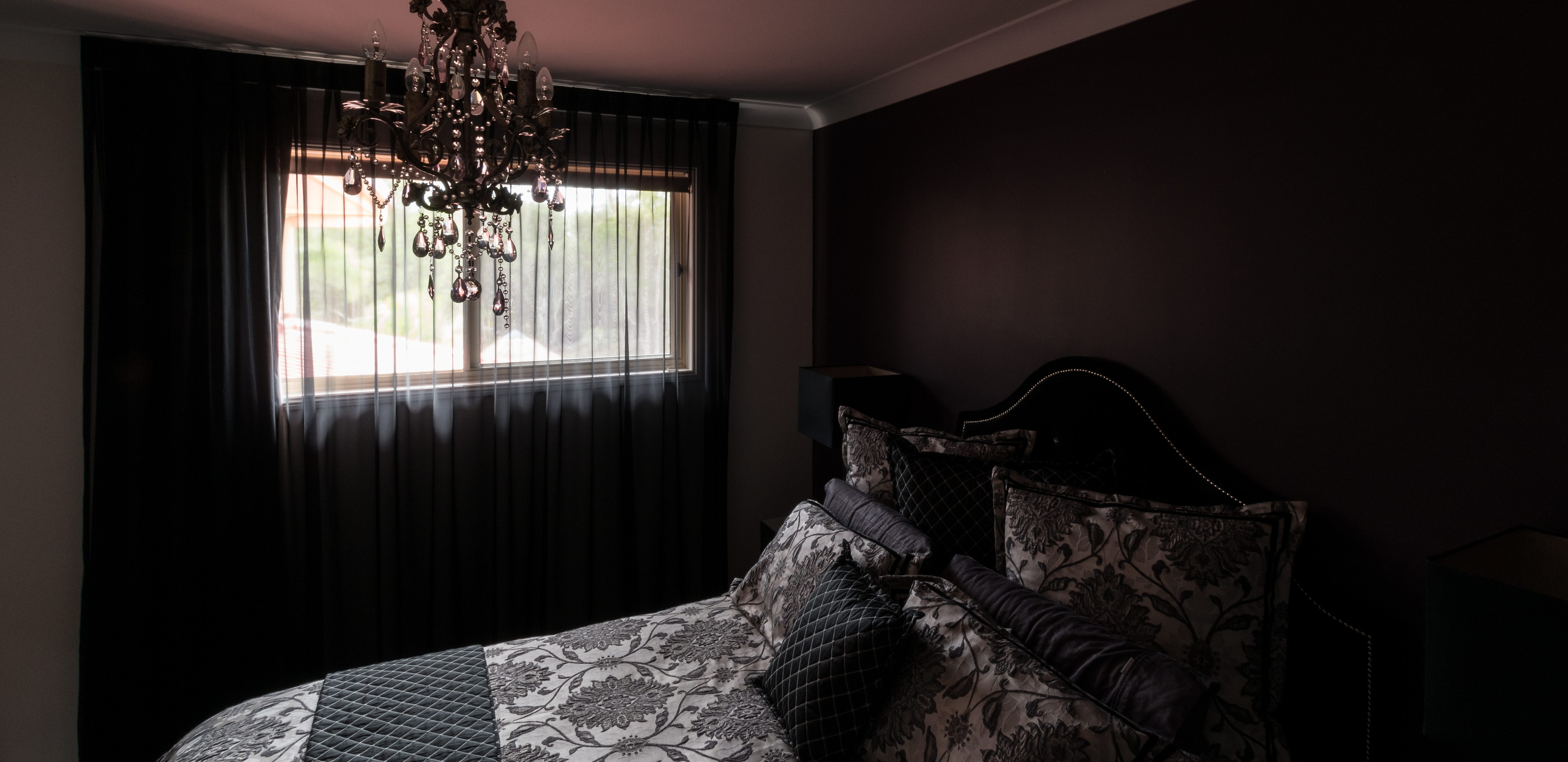 Black sheer from ceiling over black blockout from under cornice - sheers