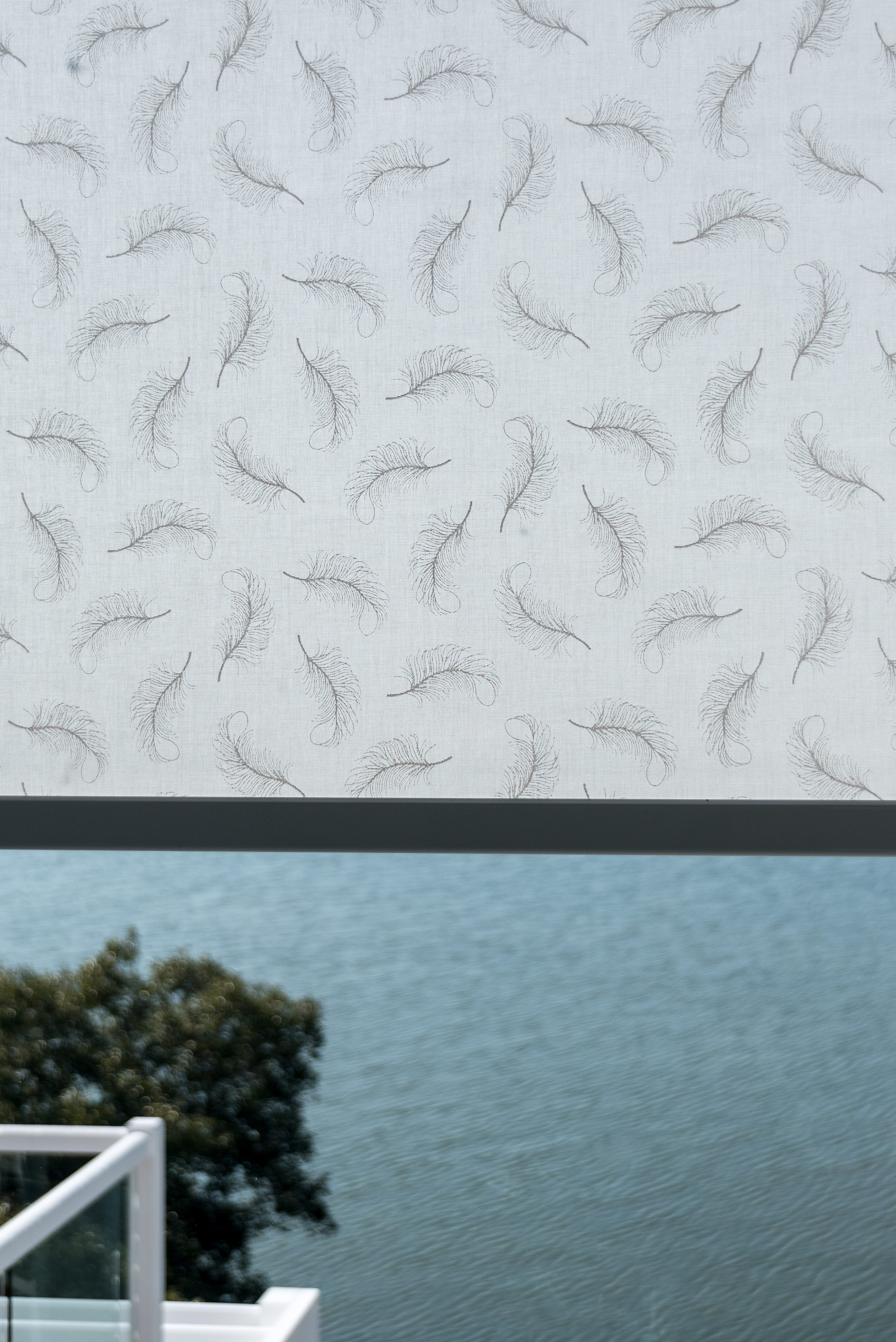 Patterned sun control blind