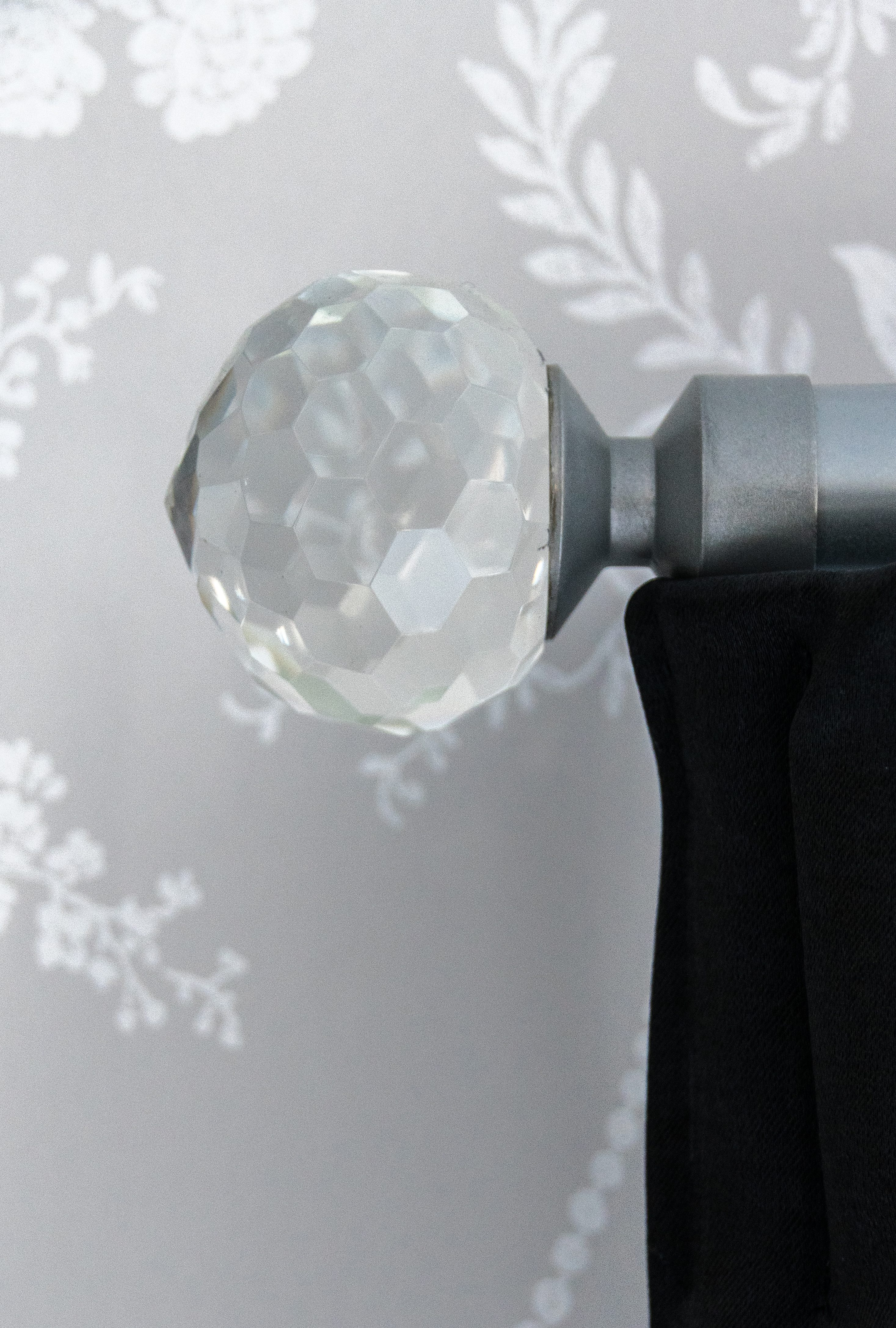Crystal finial on rod with black curtains-closeup2